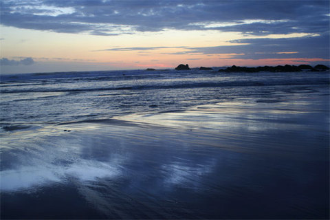 Bude sunset reflecting in the wet sand